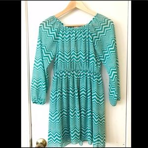 Teal and white long sleeved zig zag pattern dress